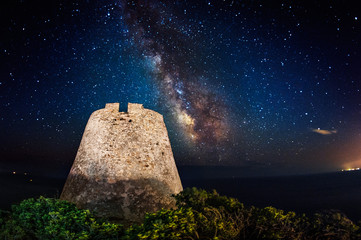 Ancient coastal tower under the milky way