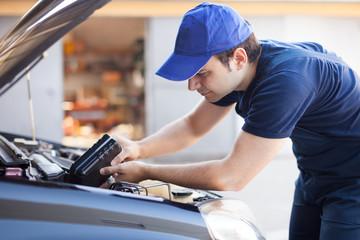 Mechanic servicing a car engine