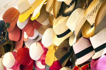 Beautiful colorful summer straw hats are line up