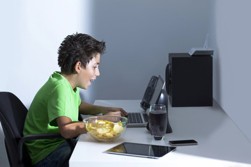 Game illness young boy is playing game on computer