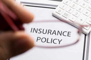Insurance Policy with Glasses