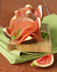 ripe purple figs with smoked ham - traditional appetizer