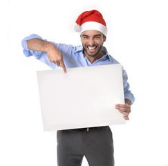 attractive man in santa christmas hat pointing blank billboard