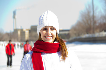 Winter portrait of an attractive woman with a red scarf