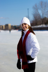 Portrait of a young woman on a skating rink