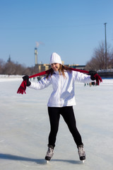 Young woman ice skating during winter