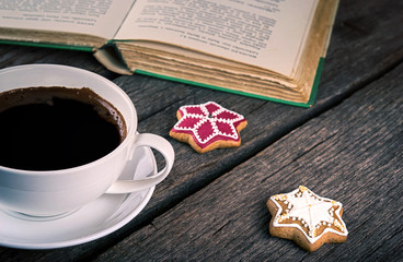 Cup Of Coffee with Gingerbread cookies and book