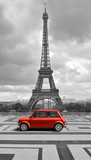Fototapeta Wieża Eiffla - Eiffel tower with car. Black and white photo with red element. © cranach