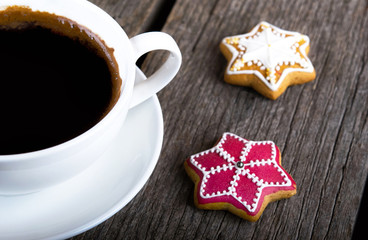 Cup Of Coffee with Gingerbread cookies on wooden background