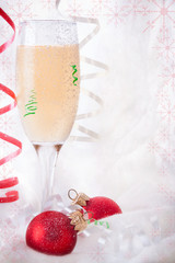 Glass with Champagne and Christmas baubles