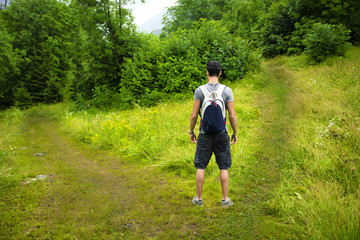 Young man facing choice between two different paths