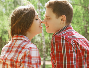 Sensual couple kissing in summer day