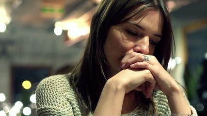 Sad beatiful woman drinking wine in bar late at night