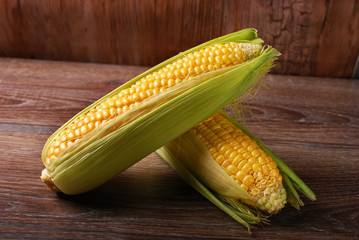 fresh sweet corn on wooden background