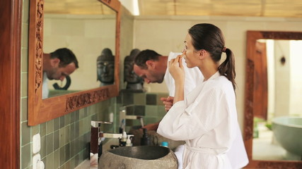 Young couple during morning routine in bathroom