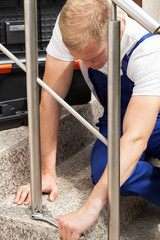 Repairman working on staircase