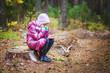 little girl on stump