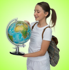 Smiling young schoolgirl with a globe