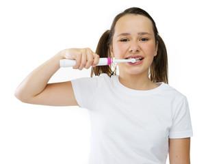 Healthy cute girl brushing her front teeth