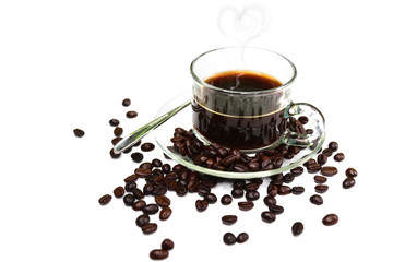 Black Coffee in Glass cup and beans on a white background.