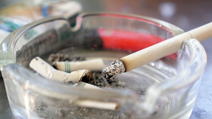 Burning Cigarette in Full Ashtray. Speed up.