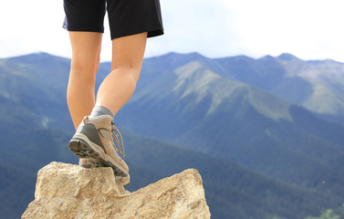 cheering young woman hiker open arms mountain peak