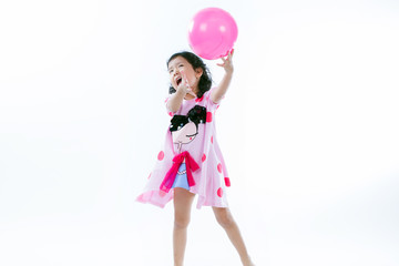Happy asian girl playing ball on white background