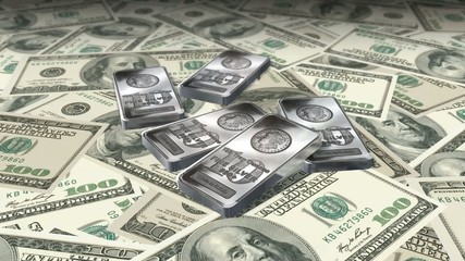 Dolly shot across $100 bills and 10 ounces silver bars