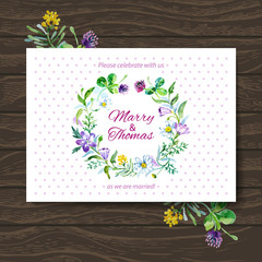 Wedding invitation card with watercolor floral bouquet.