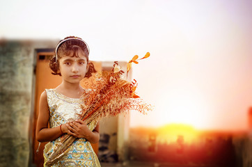 dreamy portrait of small little girl holding flowers