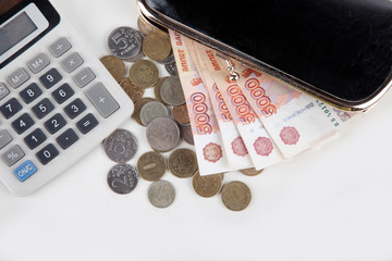 Russian money, calculator and purse