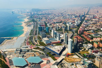 Aerial view of Barcelona with coastline from helicopter