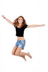Beautiful teenager girl jumping, running isolated