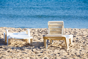 two old sunloungers on tunisian beach