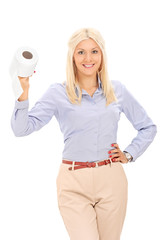 Blond woman holding a toilet paper roll
