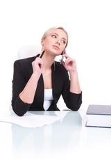 Portrait of business woman sitting on her desk.