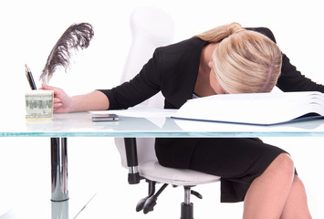 Young businesswoman sleeping on desk.