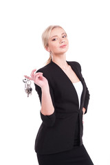 business woman holding keys over white background.