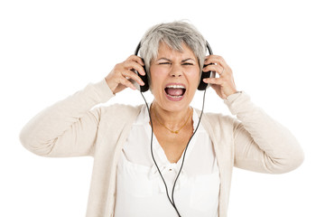 Elderly woman listen music