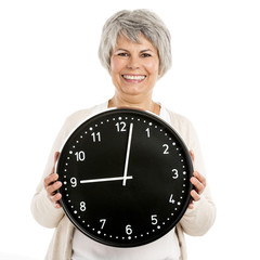 Elderly woman holding a clock