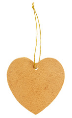 Old cardboard tag in the shape of a heart with golden thread