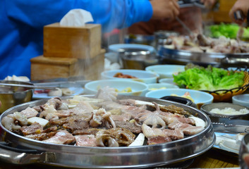 Korean barbecue - meat are being cooked on stove