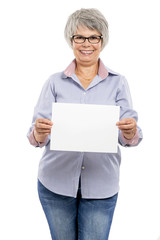 Elderly woman holding a blank paper card