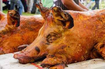 Grilled whole roasted pig Spit roasting is a traditional