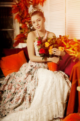 oung beautiful woman in vintage dress on autumn porch. Beauty gi
