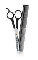 scissors and comb professional hairdresser with reflection