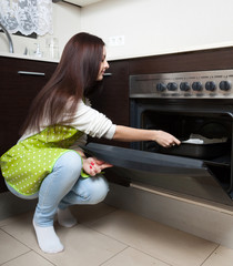 Girl  near the oven