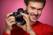 Portrait of young male with professional digital camera.