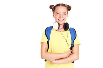 Happy schoolgirl with headphones