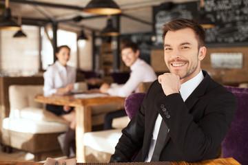 Stylish young man sitting in restaurant.